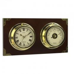 Horloge et baromètre sur panneau de bois.